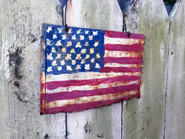 tweexy American flag image on fence for Station 22, LLC