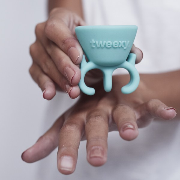 tweexy being placed on hand using the squeeze tabs feature